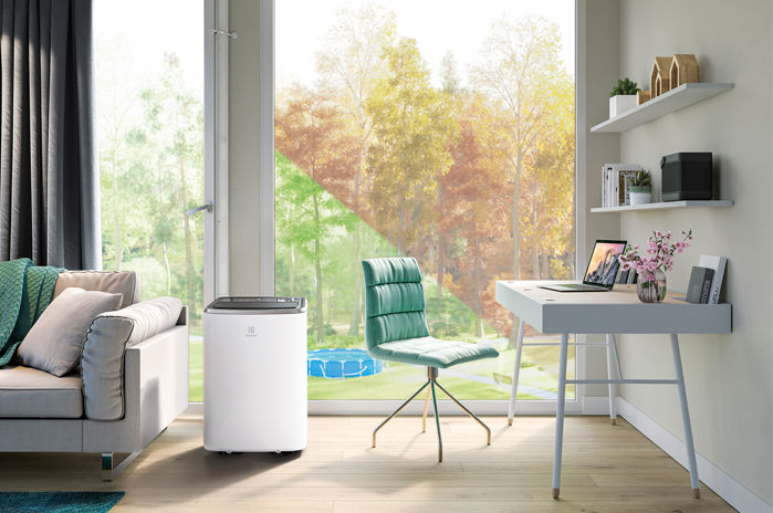 Klimatyzator przenośny Electrolux EXP34U338HW w pokoju